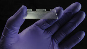 CAPTION: © Fraunhofer USA ## Photograph of the microfluidic layer showing the 31-mm x 46-mm footprint. The total volume of the microfluidic channel is 20 µL.